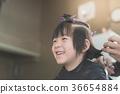 Asian boy getting haircut 36654884
