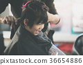Cute Asian boy getting haircut  36654886
