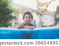 Cute Asian boy swimming and playing in a pool 36654895