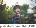 Portrait of happy Boy in blue helmet standing 36654901