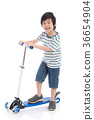Asian boy riding a scooter on white background 36654904