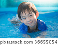 Cute Asian boy swimming and playing in a pool 36655054