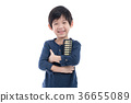 Asian child holding Soroban abacus 36655089