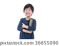 Asian child holding Soroban abacus 36655090