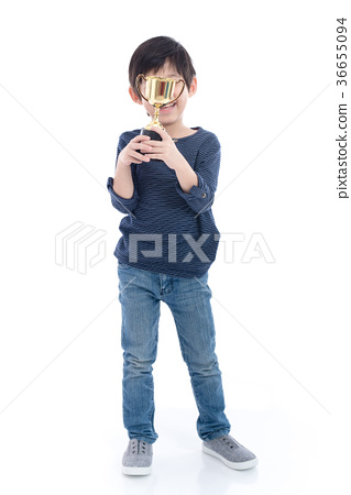 Asian child holding up a trophy 36655094