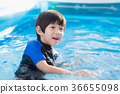 Boy swimming and playing in a pool 36655098