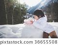 little boy with snowman 36655508