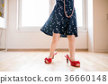 Unrecognizable little girl in dress and red high 36660148
