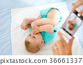 Parent taking photo of a baby with smartphone 36661337
