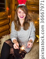 Girl having fun with fire sparkles 36667971