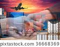 Double exposure business hands shaking  36668369