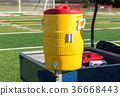 Yellow water cooler on cart 36668443