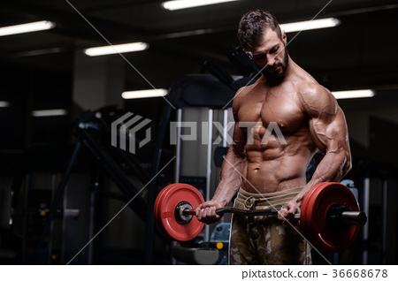 sexy strong bodybuilder athletic men pumping up muscles with dum 36668678