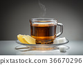Hot tea, sugar, and lemon. 36670296