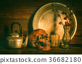 Human skull and flower vase on wooden table  36682180