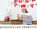 Asia woman smile open gold xmas gift at party 36684370