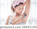 Beautiful girl shaving armpit hair by razor 36693149