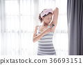 Beautiful girl shaving armpit hair by razor 36693151