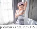 Beautiful girl shaving armpit hair by razor 36693153