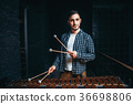 Young male xylophone player with sticks in hands 36698806