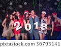 Teenagers are celebrating at the night party. 36703141