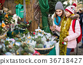 Girl with mother choosing floral decoration 36718427