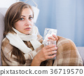 Sick girl on sofa taking drugs 36719570