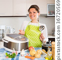 Woman cooking with multicooker 36720569