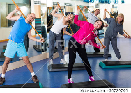 Group of people exercising in a fitness club 36720796