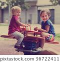 Two happy little sisters on teetering board 36722411