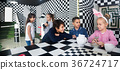 five kids discuss the game in the chess quest room 36724717