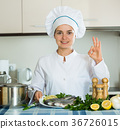 Professional chef cooking fresh trout at kitchen 36726015