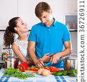 Young family couple cooking vegetables 36726911