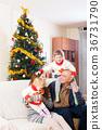 Family on sofa at christmas 36731790