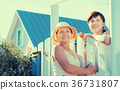 Two women near fence wicket 36731807