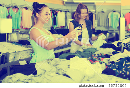 Young women friends shopping pants in shop 36732003