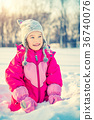 Little girl in a winter park 36740076