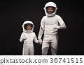 Positive cosmonauts man and boy are expressing joy 36741515