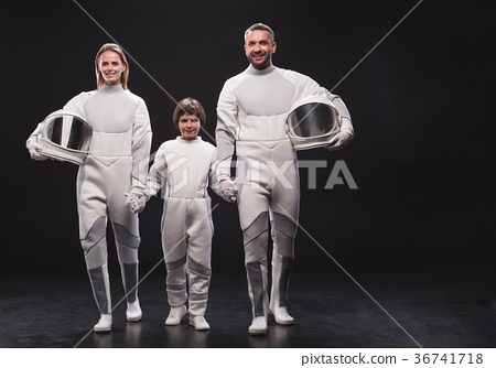 Positive couple of cosmonauts with their child are 36741718