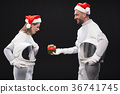 Surprised woman is accepting christmas box from 36741745