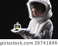 Pleasant trained little astronaut is looking at 36741846
