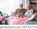 Excited senior husband and wife with book at 36742714