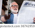 newspaper, man, senior 36742959