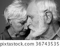 Loving aged serene couple embracing each other 36743535
