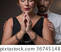 Desperate woman is chained with handcuffs by her 36745148