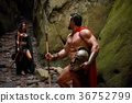Spartan warrior and his woman in the woods 36752799