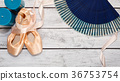 Ballet shoes and show props on wooden stage 36753754