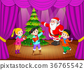 santa claus on the stage with kids singing 36765542
