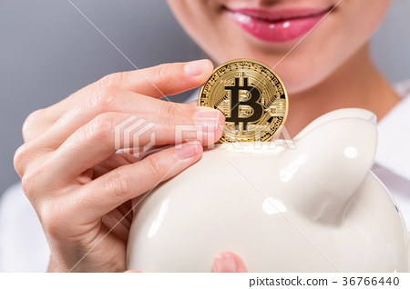 Woman with bitcoin and piggy bank 36766440