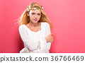 Beautiful young woman with a garland  36766469